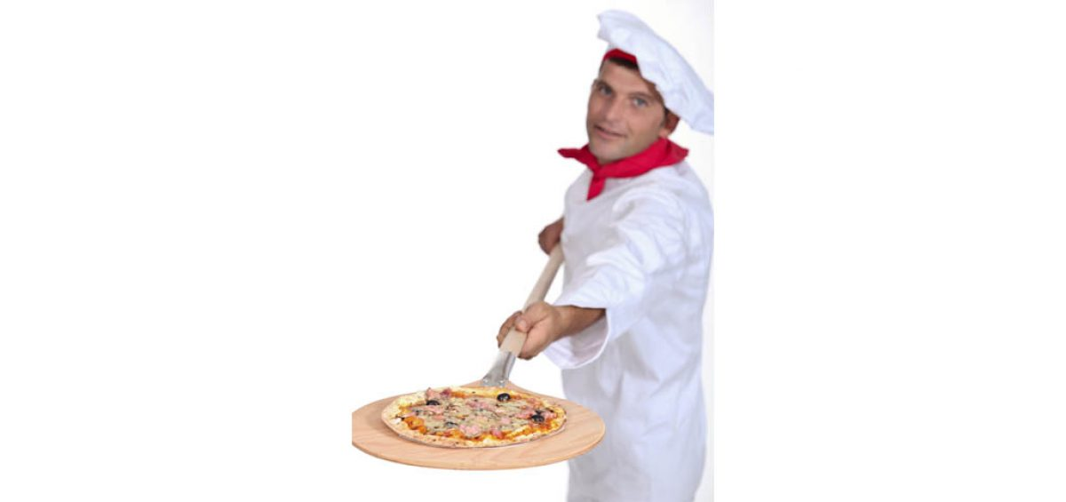 A stock photo of a chef holding a pizza board, used in a composite image for Rosati's, created by Roselle Premedia company Controlled Color, Inc.