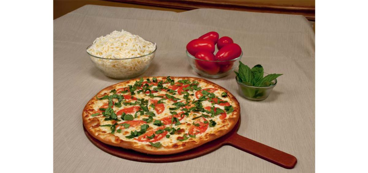 A Margharita pizza, food photography used in a composite image for Chicago Pizza Authority, created by Roselle Premedia company Controlled Color, Inc.