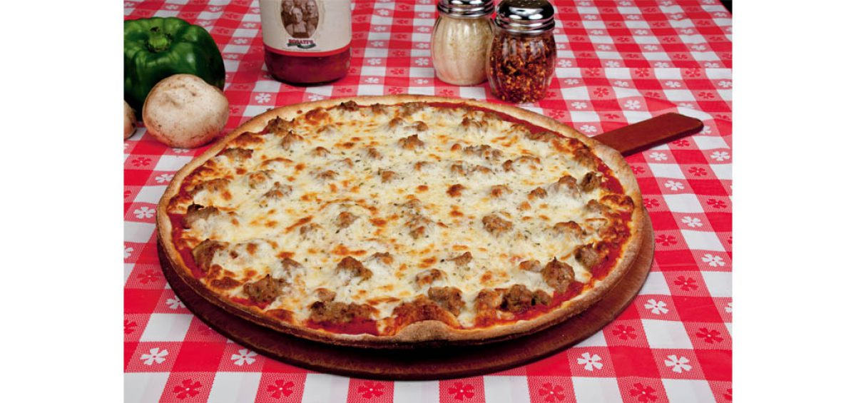 A thin crust sausage pizza, food photography used in a composite image for Chicago Pizza Authority, created by Roselle Premedia company Controlled Color, Inc.