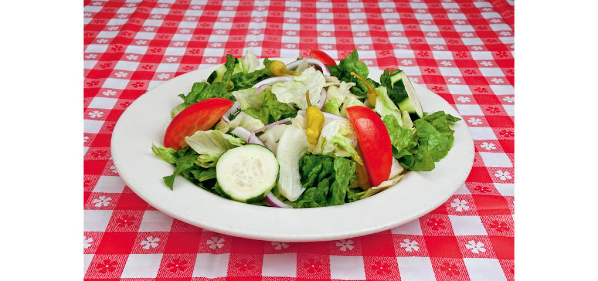 A fresh garden salad, food photography used in a composite image for Chicago Pizza Authority, created by Roselle Premedia company Controlled Color, Inc.